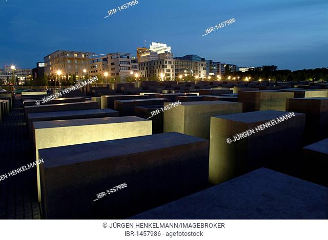 Holocaust Memorial designed by architect Peter Eisenman, memorial to the murdered jews of Europe, with a view of the skyline of the Potsdamer Platz square