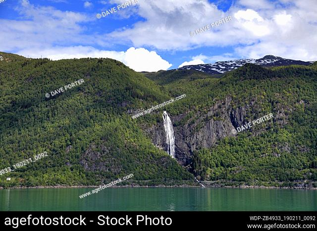 View of a waterfall and the mountains surrounding Sognefjorden Fjord, Sogn Og Fjordane region of Norway, Scandinavia, Europe