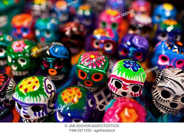 Colorful painted skulls (Calaveras) are sold on the market during the Day of the Dead celebration in Mexico City, Mexico, 28 October 2016