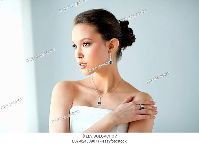 beauty, jewelry, people and luxury concept - beautiful asian woman or bride with earring, finger ring and pendant