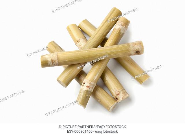 Fresh pieces of sugar cane sticks on white background