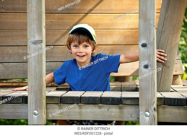 Portrait of smiling little boy at playground