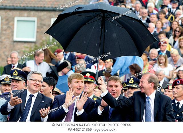 King Willem-Alexander of The Netherlands and President Bronislaw Komorowski (L) of Poland attend the 70th commemoration of operation Market Garden