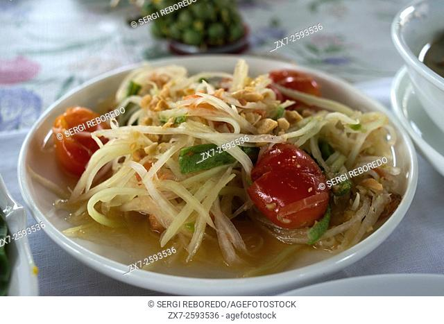 Thai papaya salad dish also known as Som Tam. Amita Thai Cooking School. Bangkok. Thailand. Amita Thai Cooking class is located within the landscape of the Chao...