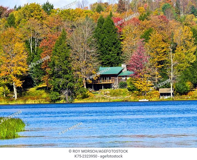 Country home on lake in autumn