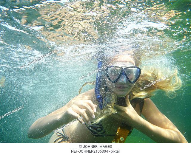 Girl swimming in scuba mask
