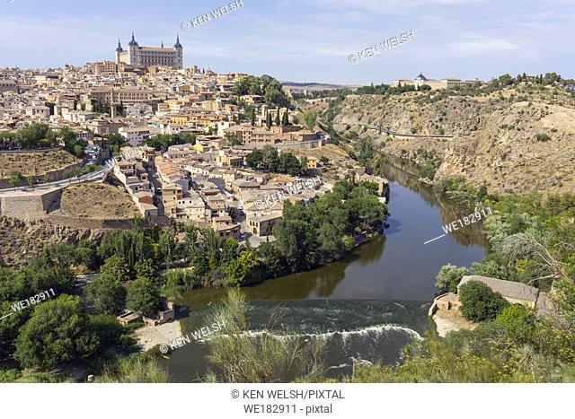 Toledo, Toledo Province, Castilla-La Mancha Spain. Overall view of the historic centre showing the Tagus River (Rio Tajo) and the Alcazar