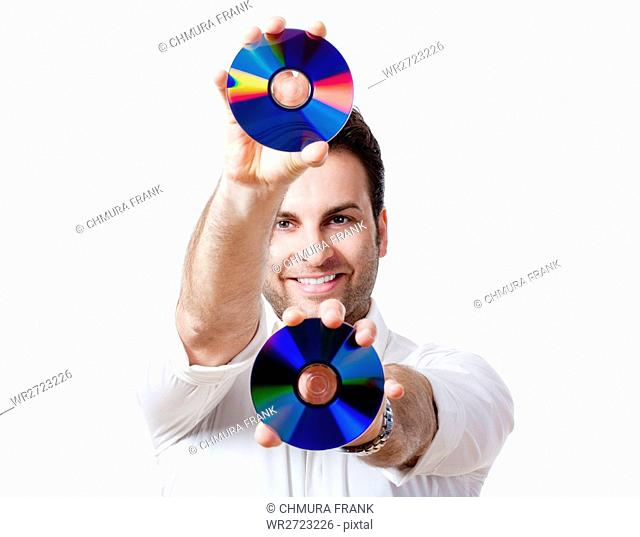 adult, background, cd, cd-rom, close, close-up, color, compact, data, disc, disk, DVD, face, fun, happy, holding, human, isolated, lifestyle, light, man, male