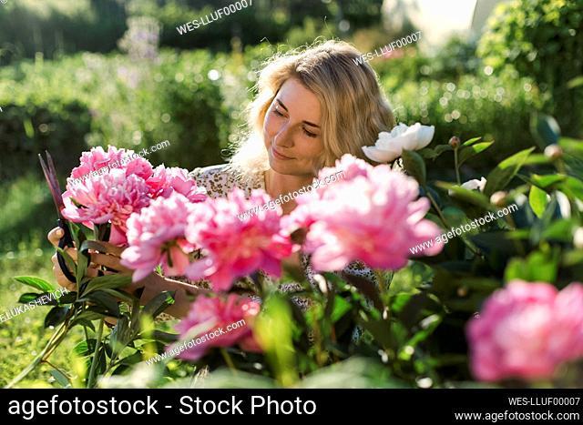 Woman cutting flowers at garden
