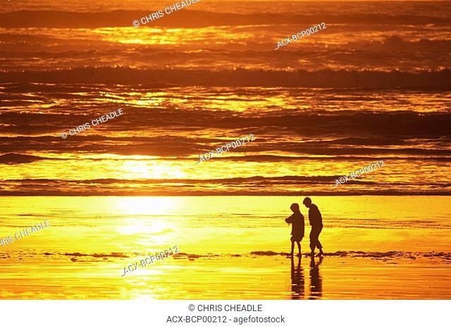 boys on beach at sunset, Pacific Rim , Tofino, Vancouver Island, British Columbia, Canada