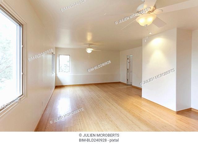 Hardwood floor in empty white room