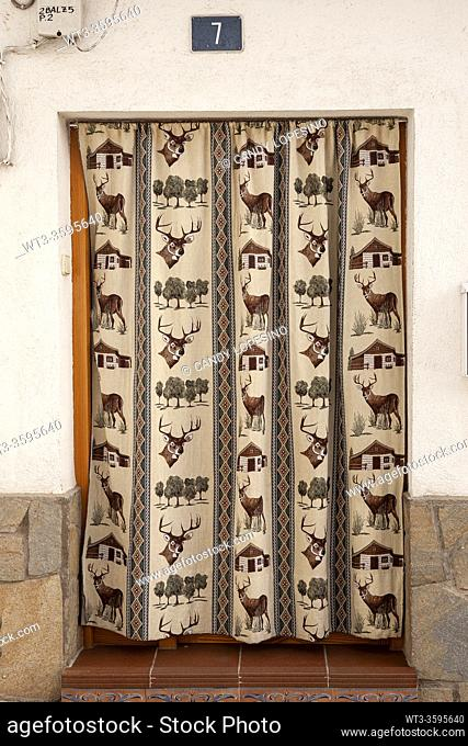 Door with hunting cloth curtain, CAMPO REAL, MADRID province, SPAIN, EUROPE