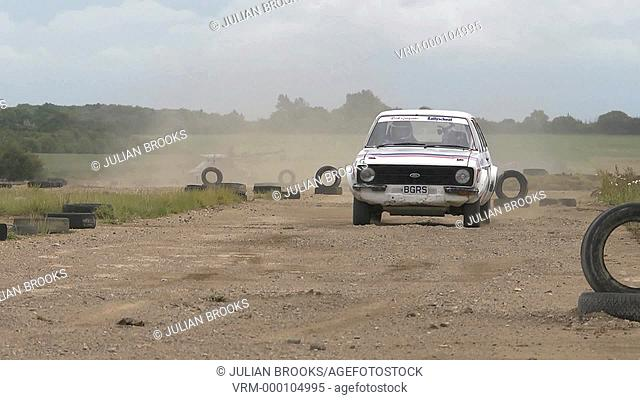 Rally car cornering - demonstrating sliding turns