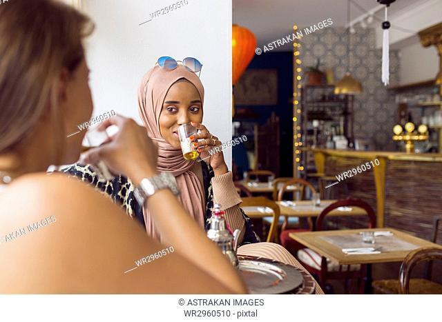 Businesswomen drinking tea in tea room