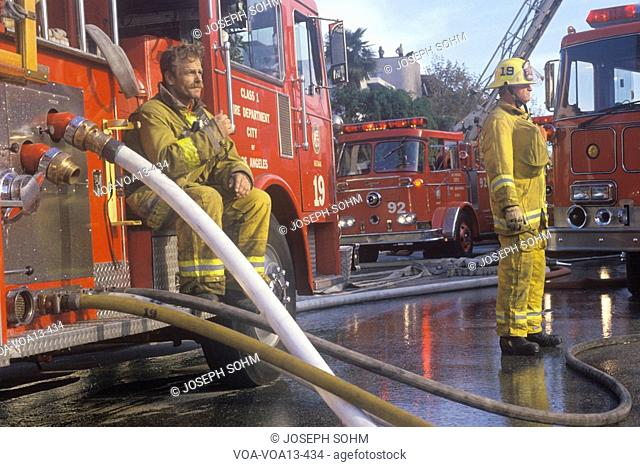 Firefighters working at apartment fire, Los Angeles, California