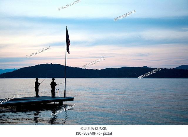 Boys fishing, Lake Pend Oreille, Idaho, USA