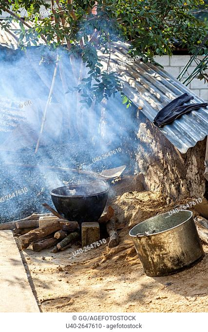 Guatemala, Poaquil, cooking pots sitting outside