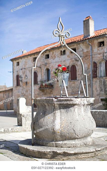the small town svetincenat has a large square surrounded by a fortress, its picturesque loggia and st. catherine's church