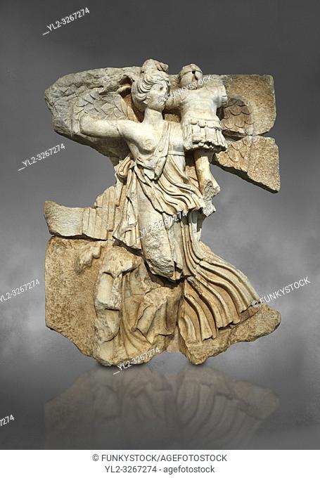 Roman Sebasteion relief sculpture of the goddess Victory, Aphrodisias Museum, Aphrodisias, Turkey. Against a grey background.