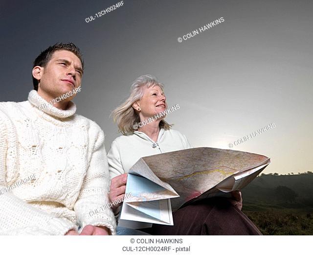 man & woman studying map
