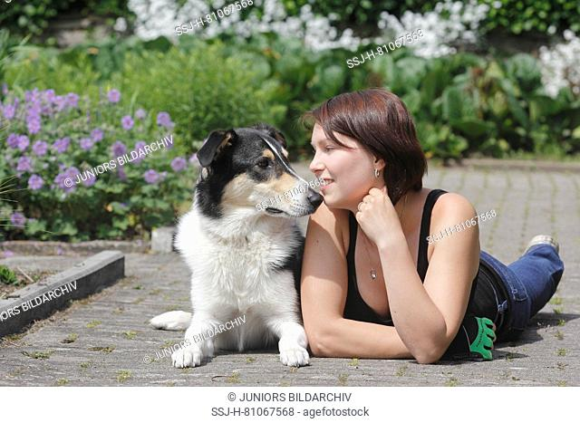 Mixed-breed dog (Bearded Collie x ?) with its owner