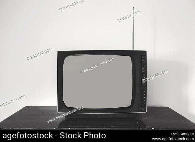 Retro old television receiver on the table front, vintage design black and white space for text