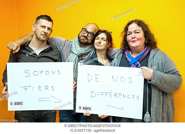 Paris, France, Group Portrait, AIDS NGO AIDES Activists, Holding Protest Signs Against Discrimination, Homophobia. 'Be Proud of our Differences'