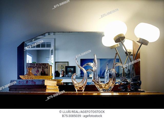 Art decó furniture, mirror, books, table lamp, decorative objects. Mahó, Minorca, Balearic Islands, Spain