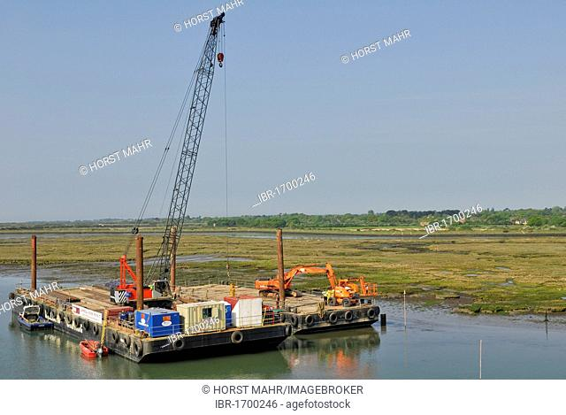Harbour construction site with cranes and excavators on pontoons, Lymington, southern England, England, United Kingdom, Europe