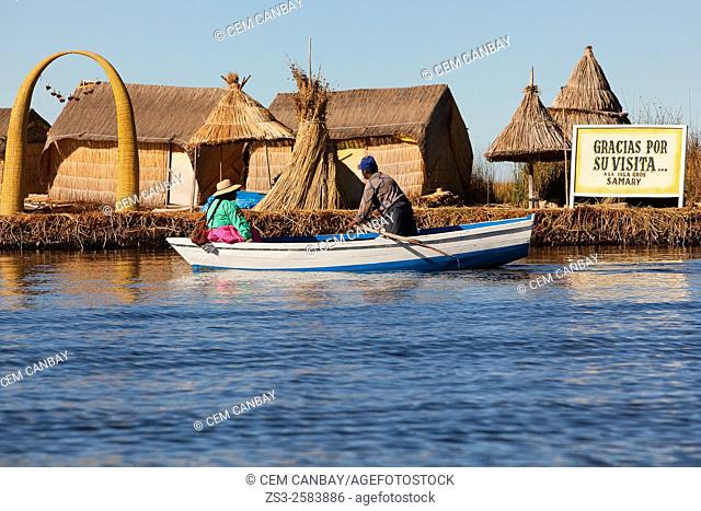 Aymara people in a row boat near an island, Uros Islands, Lake Titicaca, Puno Region, Peru, South America