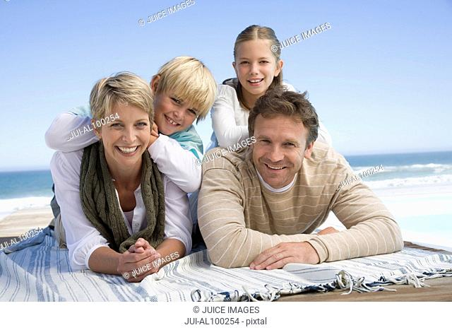 Family relaxing on beach