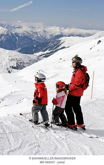 Familiy is skiing in the Zillertal Tyrol Austria
