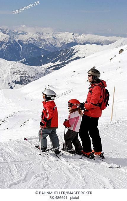 Familiy is skiing in the Zillertal Tyrol Austria