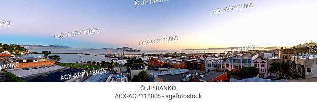 Panoramic image featuring North Point neighborhood, Alcatraz, Fishermans Wharf and San Francisco bay at daybreak