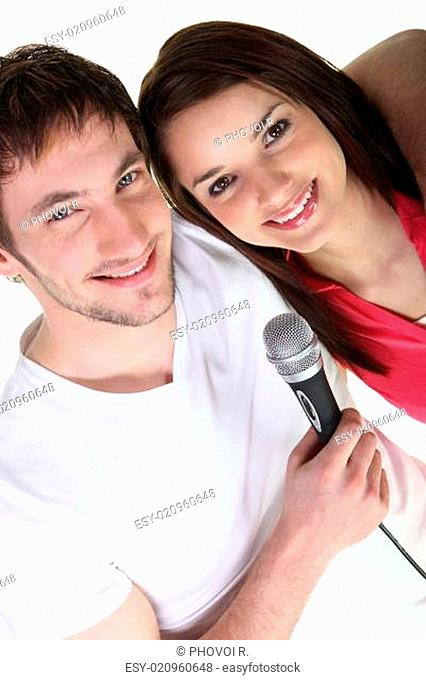 Boy and girl singing