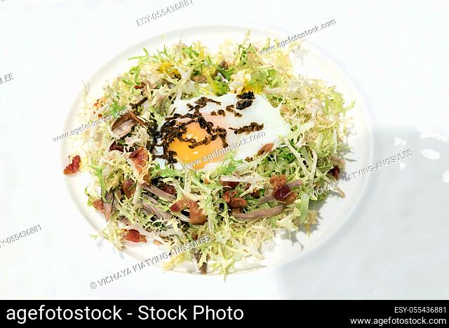 Egg salad with duck confit, groumet French Cuisine