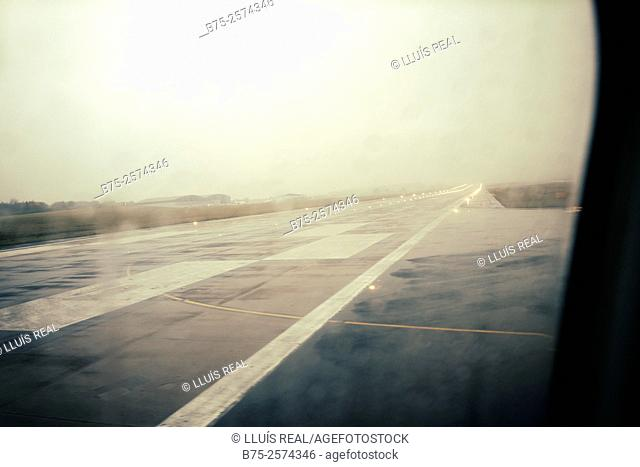 View from the window of an airplane of the airport runway in Leeds Bradford. Yorkshire, England, UK, Europe