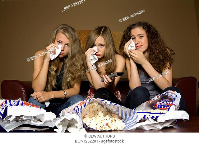 Girls crying while watching movie