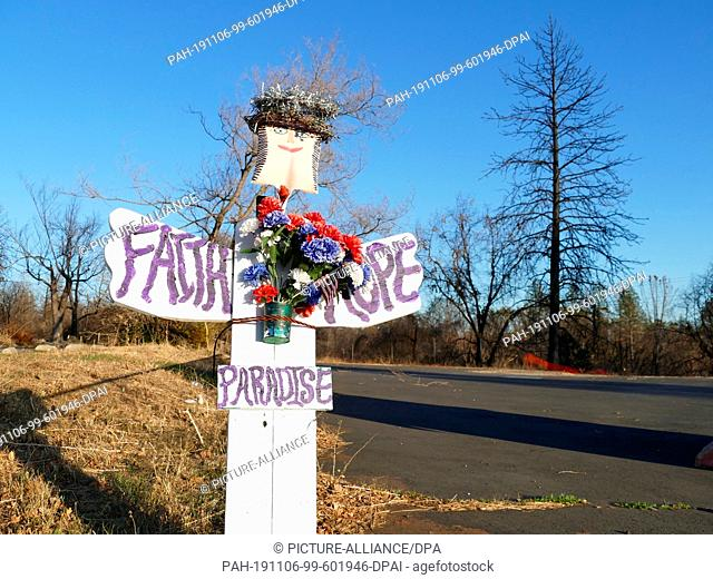 01 November 2019, US, Paradise: A sign with the inscription Faith (trust), Hope (hope) and Paradise stands at the roadside. On 08.11