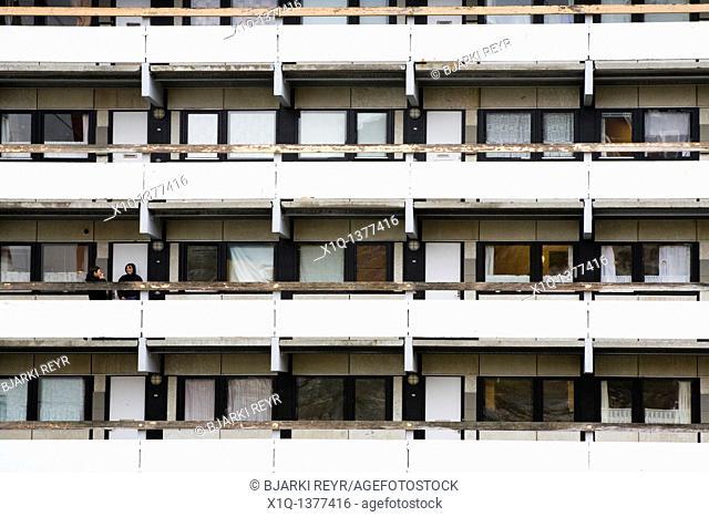 People on the balcony, residental apartments, Qaqortoq Julianehåb, South Greenland