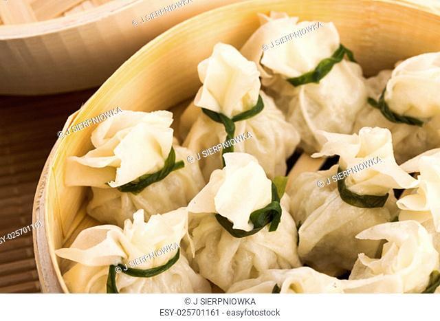 Chinese dumplings in bamboo steamers