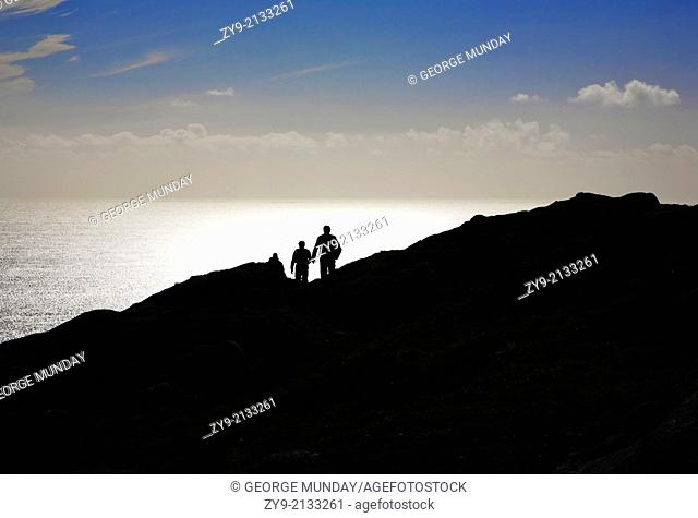 Silhouetted Hikers on Bear Island, County Cork, Ireland