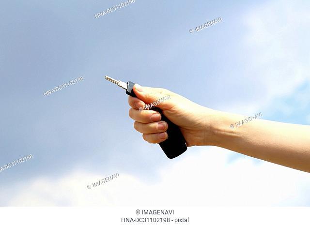 Woman Hand Holding Key