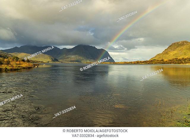 Rainbow above the fjord, Bostad, Vestvagoy, Nordland, Lofoten Islands, Norway