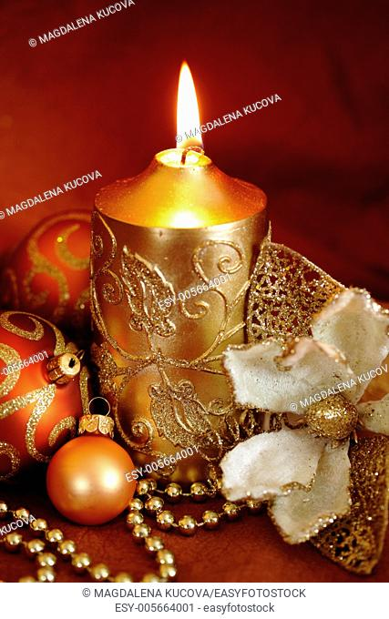 Christmas still life - candle, decorative flower and ornaments