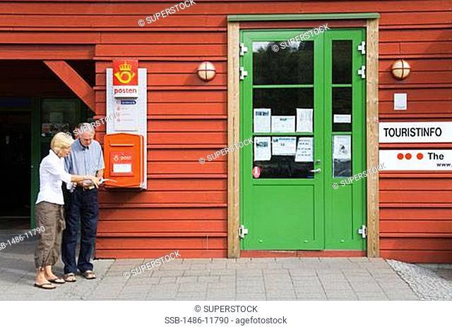 Senior couple reading a tourist map, Flam, Aurlandsfjord, Sogn Og Fjordane, Norway