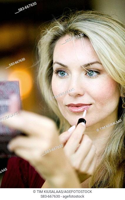 Woman applying makup