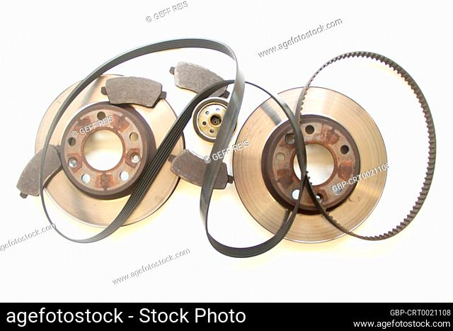 Pair old car brake disc, pads, oil filter and belt isolated on white background, São Paulo, Brazil