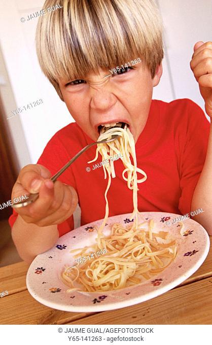 Boy eating noodles