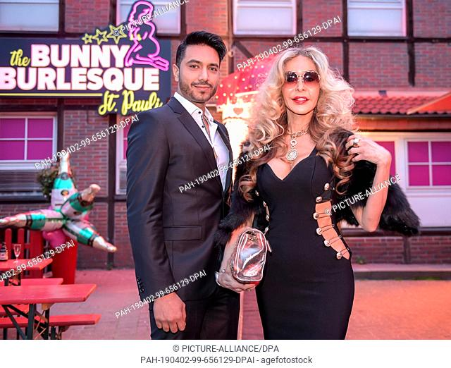 """02 April 2019, Hamburg: The actress Dolly Buster celebrates the opening of the burlesque nightclub """"""""The Bunny Burlesque"""""""" in front of the front door with her..."""